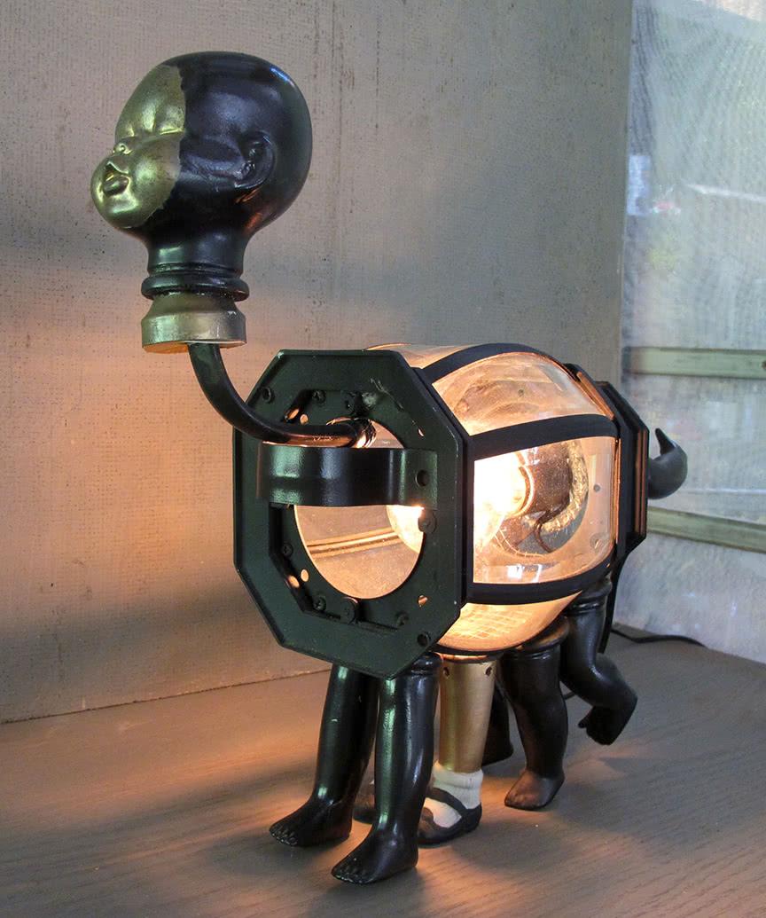 The Hippensteel Lamphead mixed media functional light sculpture by Ramona Jan